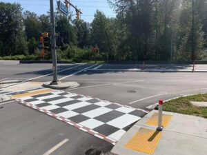 TrafficPatterns checkerboard crosswalk asphalt installation